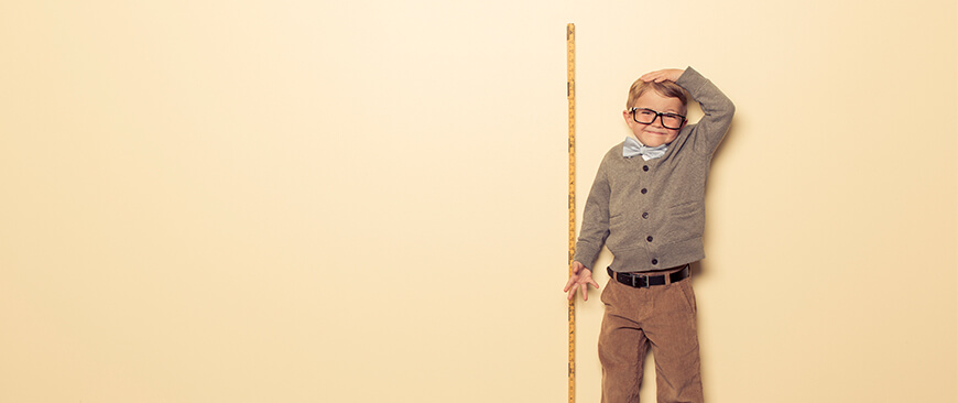 Boy With Measuring Stick